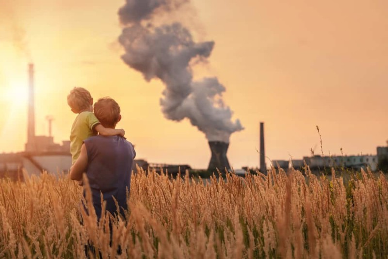 child and father looking at power plant
