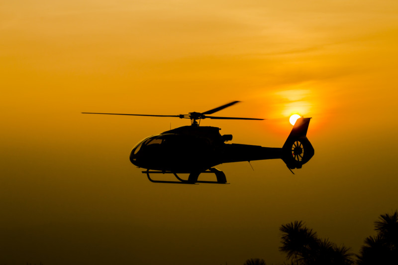 Helicopter over sun