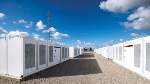 Co-locating renewables and batteries: assessing the operational implications